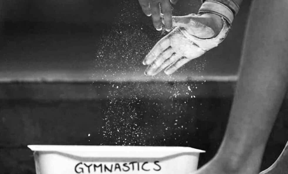 Gymnast powdering hands